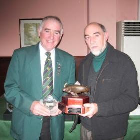 stanley-mccart-presents-ian-pollock-with-the-norman-ogilby-trophy-for-heaviest-trout-in-the-lough-section