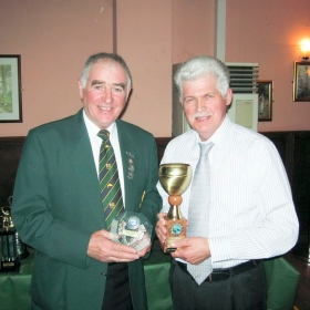stanley-mccart-presents-winston-mclaughlin-with-the-trophy-for-heaviest-salmon-2009-a-salmon-of-11lbs